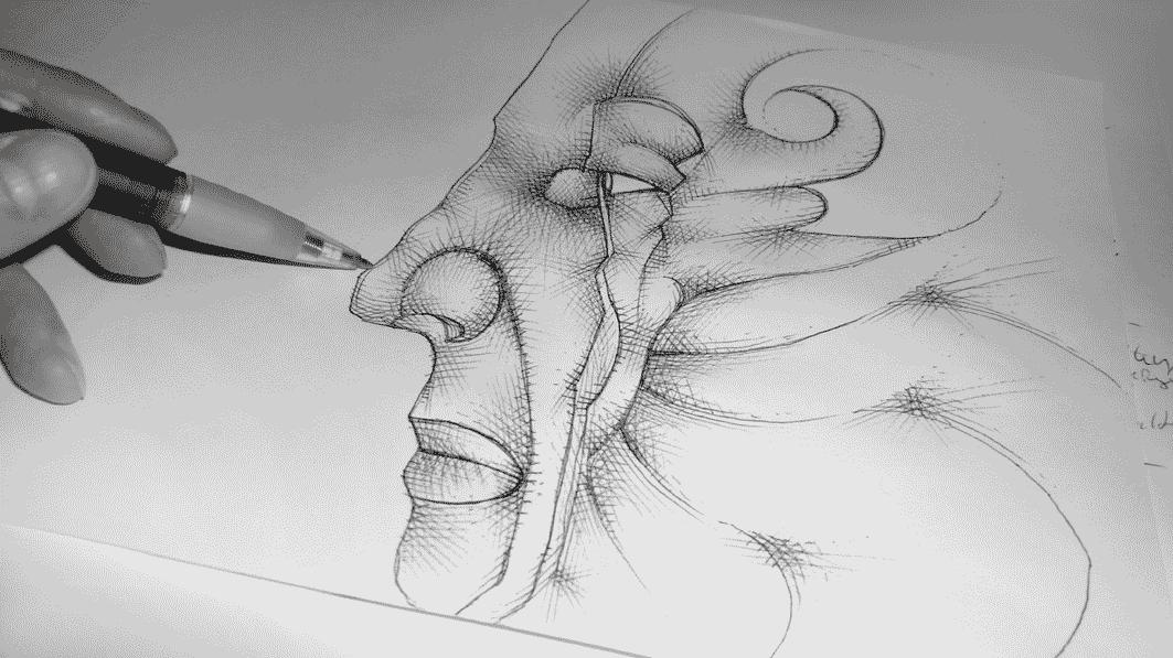 Ein Kugelschreiber zeichnet ein Gesicht.